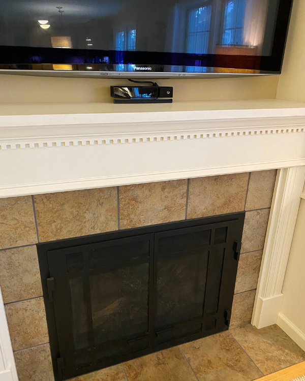 How the mantel and tile looked before the makeover.
