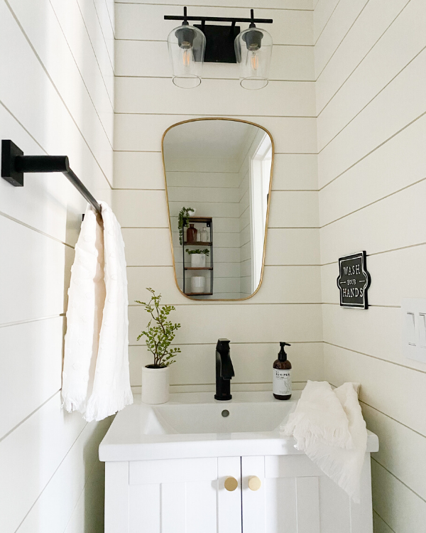 Bathroom with shiplap painted in SW alabaster, one of my favorite paint colors.