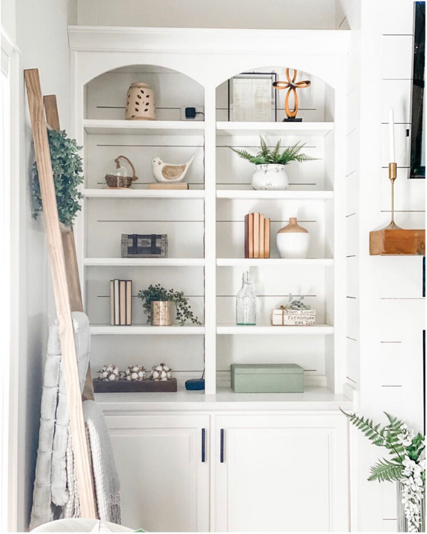 There are a variety of sizes used in her shelf styling.