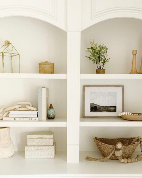 She used different textures when styling her shelves like wood, wicker, glass and ceramic.