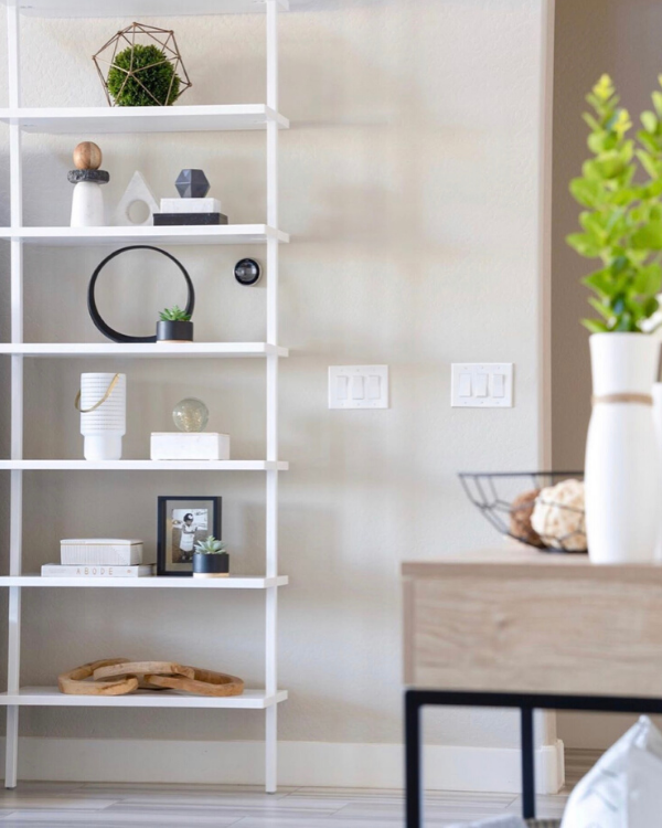 She used geometric shapes when styling her shelves,