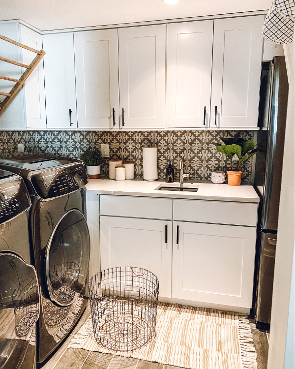 Cabinets in the laundry room in the basement for extra storage. Storage is one of the 10 things you won't regret doing when finishing a basement.