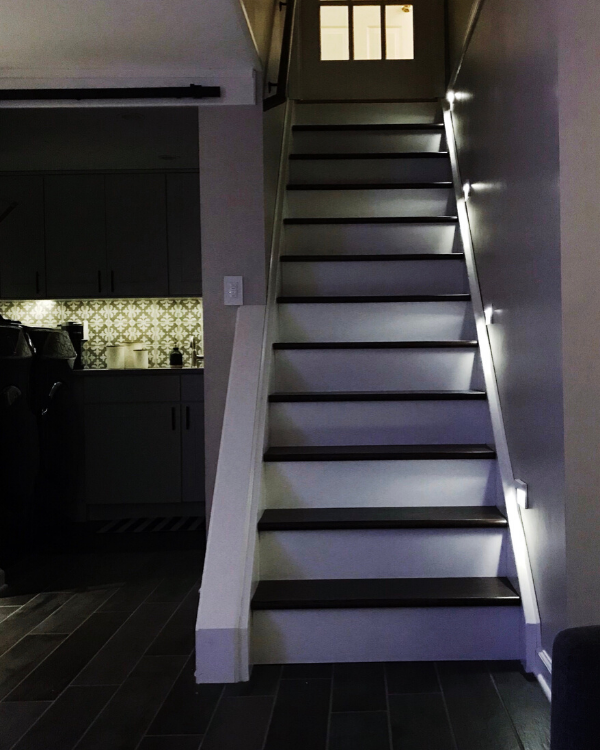 Stair lights in the basement at night. You won't regret adding them when finishing the basement!