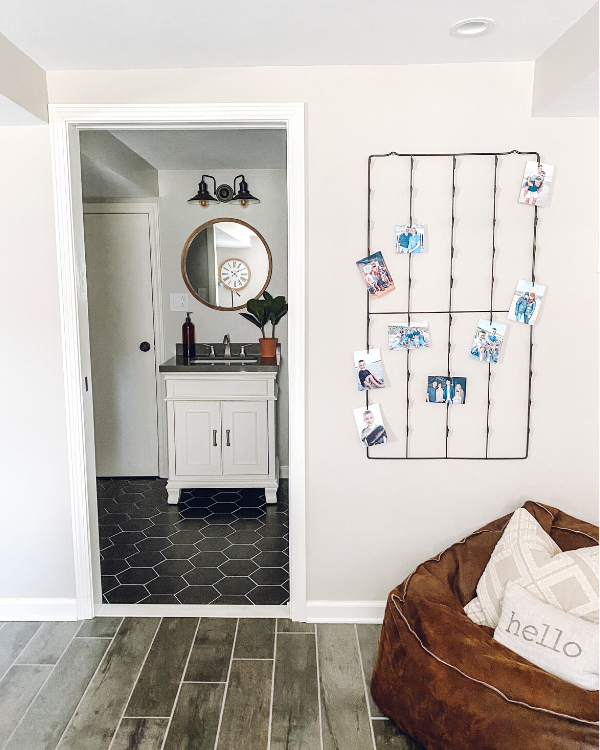 You won't regret using a pocket door to the bathroom in the basement.