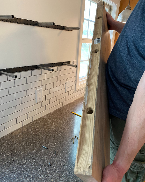 Getting reading to line up the open shelves onto the brackets