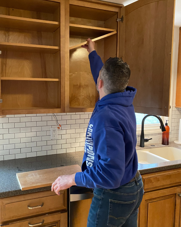 Removing the shelves out of the cabinet first.