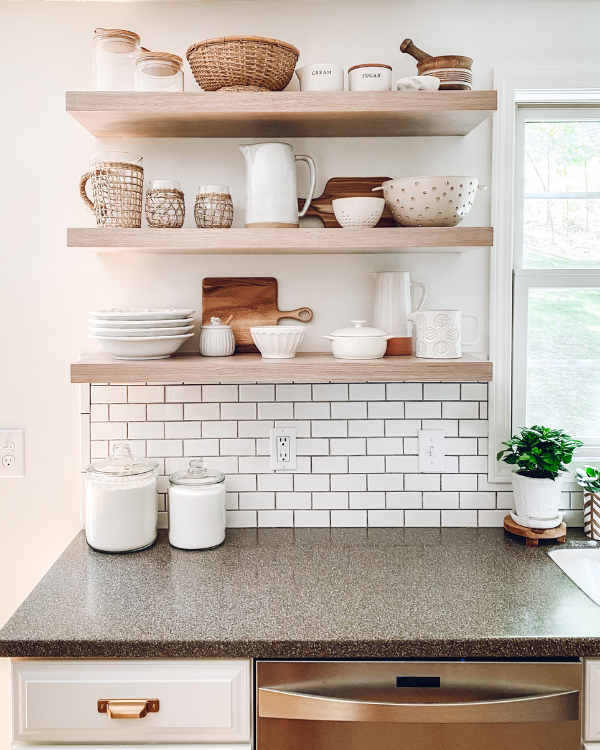 The floating shelves decorated with neutral items